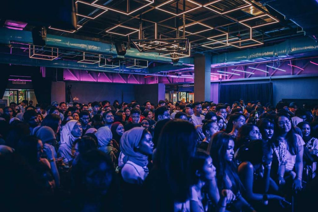 crowd watches dj play set from trax dj hire at a venue in the city of melbourne