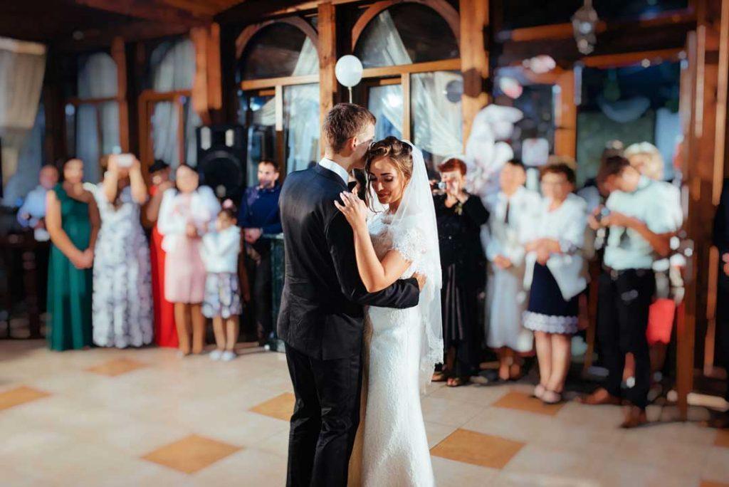 slow dancing couple to wedding music dj